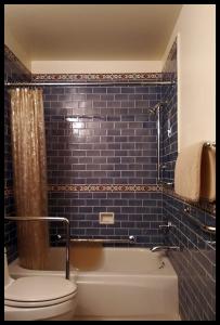 multiple H & H grab bars in tiled bathroom